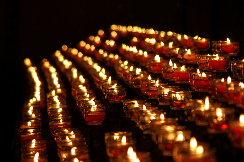 Rows of red candles Burning Candlelights Candles Church Close-up Comfort Faith Flame Heat - Temperature Hope Illuminated In A Row Indoors  Large Group Of Objects Meditation No People Peaceful Place Of Worship Red Religion Spirituality Tea Light Yellow