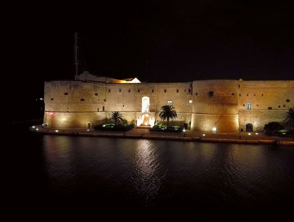 Themostbeautifulcity  Illuminated Architecture Night Building Exterior Water History Dark City Life Waterfront Sea Surface Level Historic History Castel🏰✌️👌✅😘 Aragonesecastle Taranto Dark Sky Nightview Night