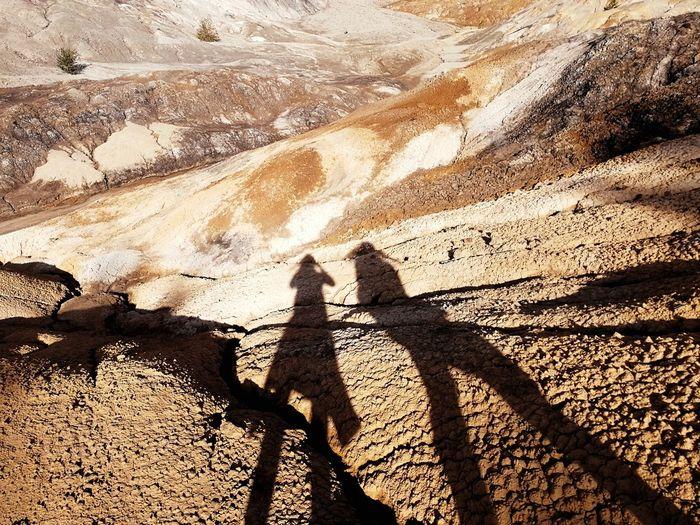 Shadow of people on rock