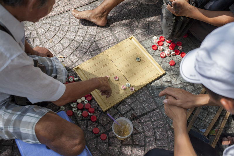 gambling Citylife Friendship Gambling Game High Angle View Ho Chi Minh City Human Body Part In The City In The Shade Outdoors Photography Still Life Travel Vietnames Game Watching