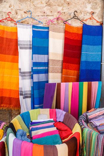 Multi colored fabrics at market stall