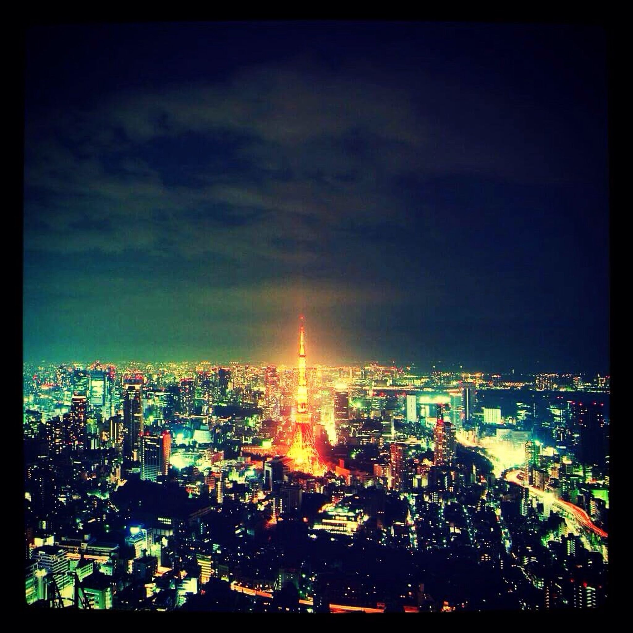 illuminated, cityscape, city, building exterior, night, architecture, built structure, crowded, sky, high angle view, residential district, residential building, skyscraper, city life, cloud - sky, residential structure, dusk, no people, outdoors, modern