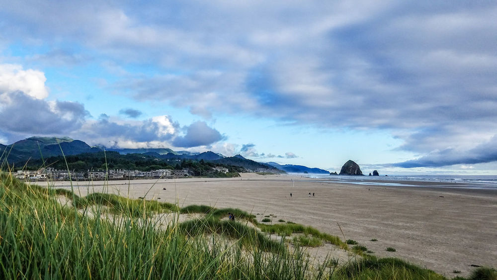 Cannon Beach, Oregon Mountain Scenics Beauty In Nature Landscape Nature Sky Beach Outdoors Travel Destinations Water Tranquility Sand Day Oregonbeach Summer Wave Cannon Beach Oregon Travel Saltwater Ocean Rocks Lowtide  Senic Relaxing EyeEmNewHere Miles Away Lost In The Landscape