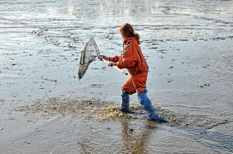 Woman fishing in sea