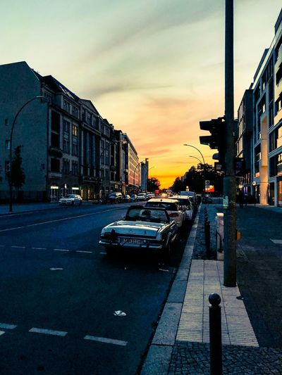 Sunset in the city streets Sunset In The City  Dusk Sunset_collection Berlin City Sky Architecture Street Motor Vehicle Building Exterior Car Mode Of Transportation Built Structure Transportation Road Sunset Land Vehicle Cloud - Sky Nature City Street Sign The Way Forward Symbol Direction