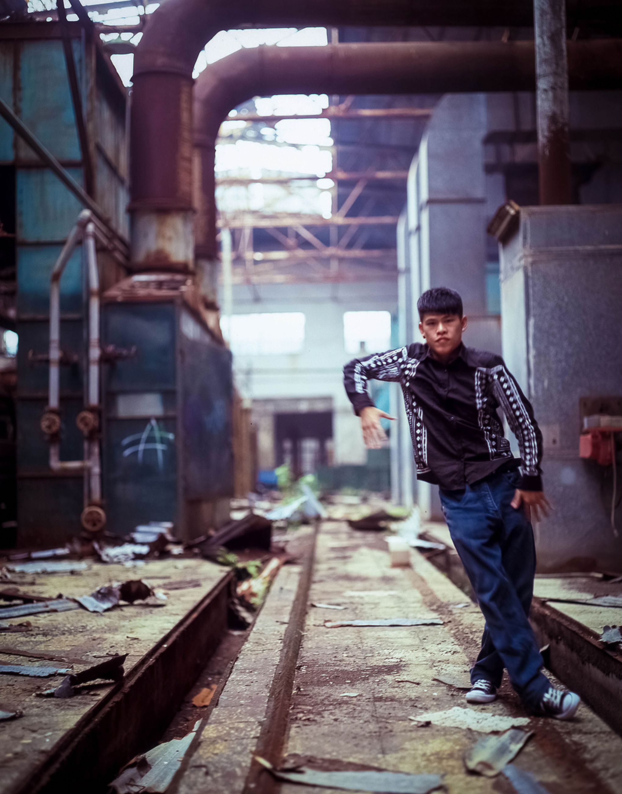railroad track, full length, lifestyles, casual clothing, built structure, transportation, rail transportation, architecture, leisure activity, standing, men, building exterior, rear view, person, sitting, working, day, abandoned