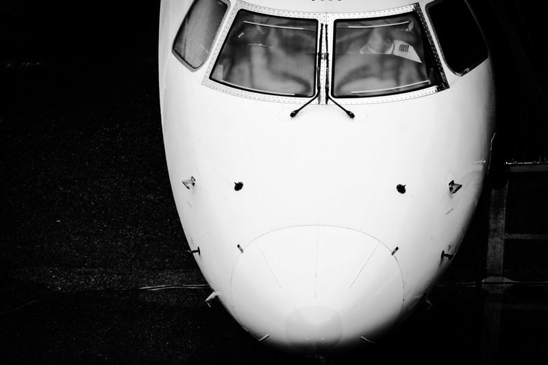 Nose of an aircraft Aviation Photography Aviation Airport Air Travel  Flight Cockpit Aircraft Industry Jet Plane Tourism Aircraft Zoom Centered Centered Perspective Copy Space Travel Marketing Travel Destinations Black White Black And White Photography Black & White In Front Black Background Close-up Airplane Airways Air Vehicle Commercial Airplane Aeroplane
