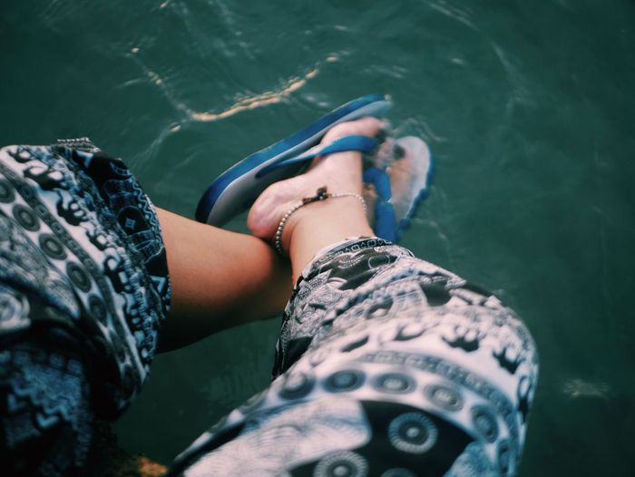 EyeEm Selects Water Real People One Person Lifestyles Low Section Human Body Part Women Body Part Leisure Activity High Angle View Human Leg Nature Adult Personal Perspective Day Outdoors Shoe Swimming Pool Human Foot Sea