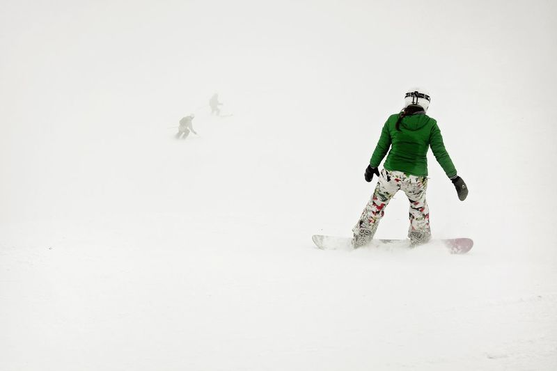Snowboarding in heavy weather Warm Clothing Snowboarding Athlete Snow Headwear Winter Sport Cold Temperature Activity Child Ski Holiday Winter Sport Skiing Ski Slope Ski-wear