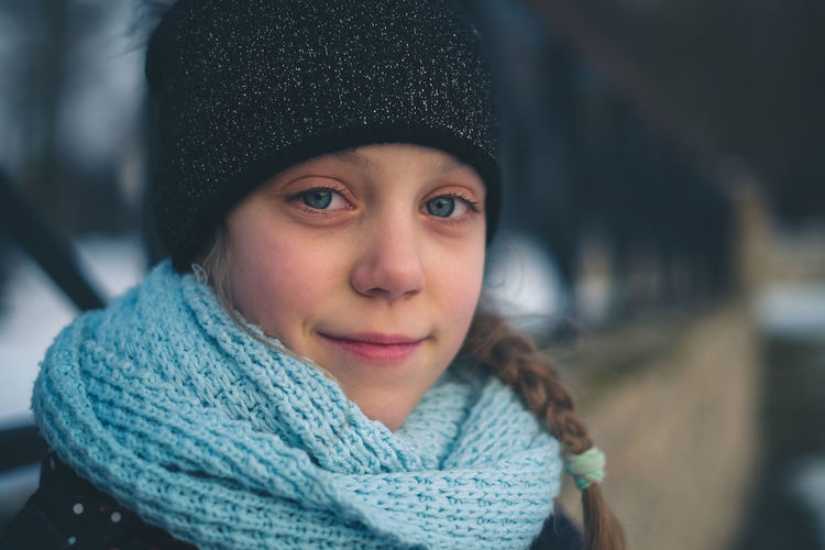 Close-up portrait of cute girl in warm clothing