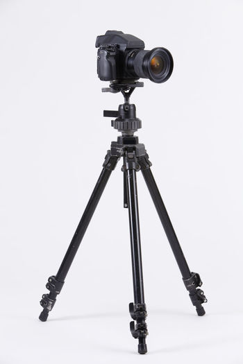 studio shot of high end digital camera on the tripod Camera Photography Multimedia Expertise Professional Occupation Tripod Photograph DSLR Lens Equipment Photographic Theme Photographing Black Nobody White Background Medium Format Camera Photography Themes Technology Studio Shot Camera - Photographic Equipment Indoors  No People Still Life Photographic Equipment Close-up Digital Camera Copy Space Single Object High End Medium Format Arts Culture And Entertainment Industrial Equipment