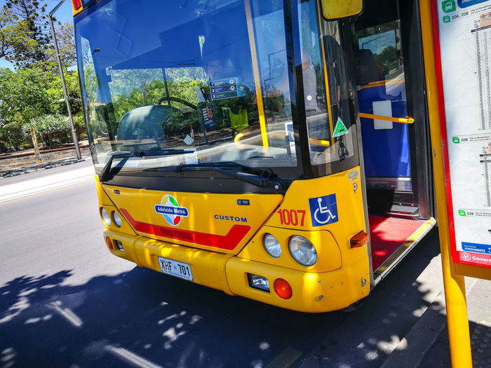ADELAIDE, SOUTH AUSTRALIA. - On November 10, 2018. – The front of yellow Metro bus is high frequency, high capacity bus network in Adelaide. Mode Of Transportation Transportation Land Vehicle Yellow Public Transportation City Day Street Architecture Bus Outdoors Road Incidental People Sign Motor Vehicle Business Adelaide Australia Traveling Metro Front View Parking Stoping Bus Stop