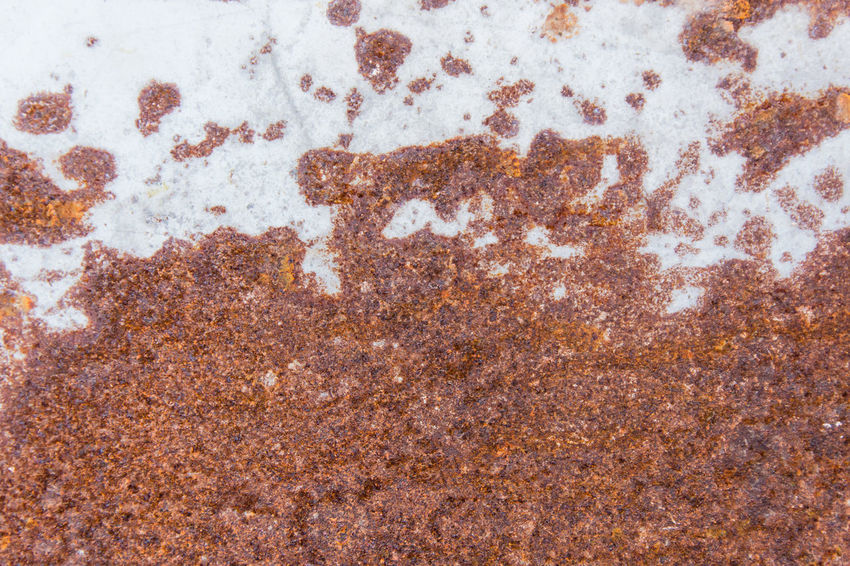 Brown rust stains texture of the old white paint on rusty metal wall. Rusty metal background. Antique Rust Textured  Architecture Backgrounds Brown Concrete Damaged Day Design Matal Material Metal Pattern Rough Rough Surface Run-down Rusted Rusty Rusty Metal Stain Stained Surface Textured  Weathered