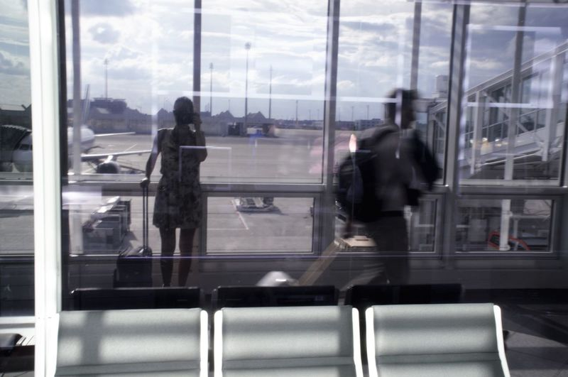 Airport Airport Departure Area Blurred Motion Day Glass - Material Group Of People Indoors  Journey Lifestyles Luggage Men Mode Of Transport Motion Passenger Public Transportation Railroad Station Railroad Station Platform Real People Train - Vehicle Transportation Transportation Building - Type Of Building Travel Walking Window Women