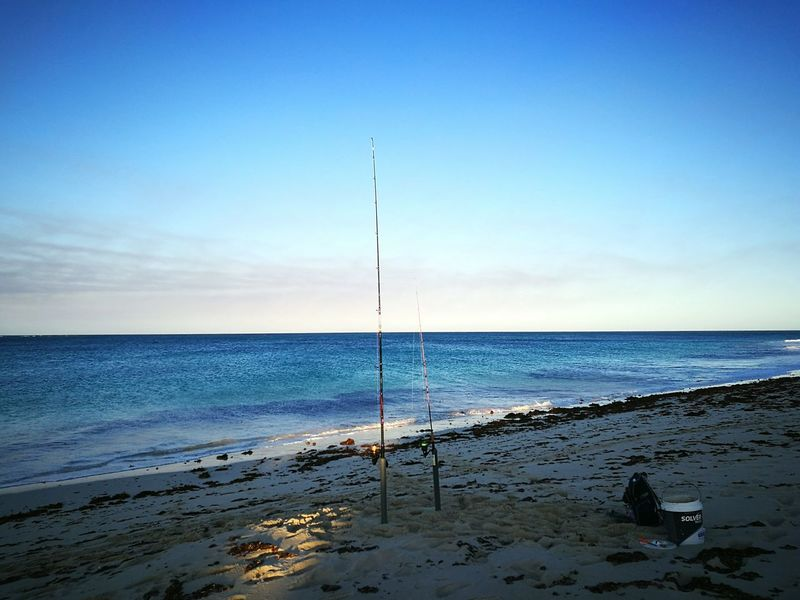 Sea Beach Water Sand Horizon Over Water Nature Sky Beauty In Nature No People Blue Scenics Outdoors Sunset Day Wave Scott Dunn Fishing Fishing Rod Summer Exploratorium