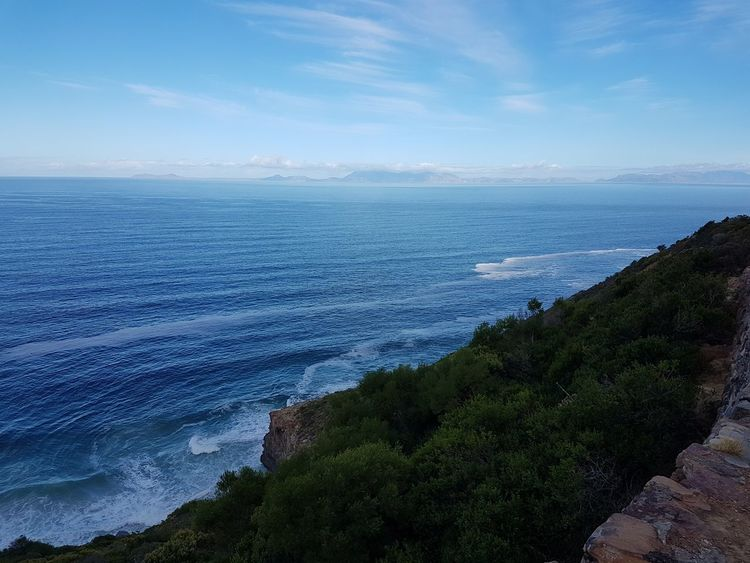 View over False Bay, sir Lowry's Pass. Point Cape of Good Hope in the far distance, South Africa Beauty In Nature Blue Sky Cape Town, South Africa False Bay Horizon Over Water Outdoors Scenics Sea Sky The Great Outdoors - 2017 EyeEm Awards Tranquil Scene Water Wave