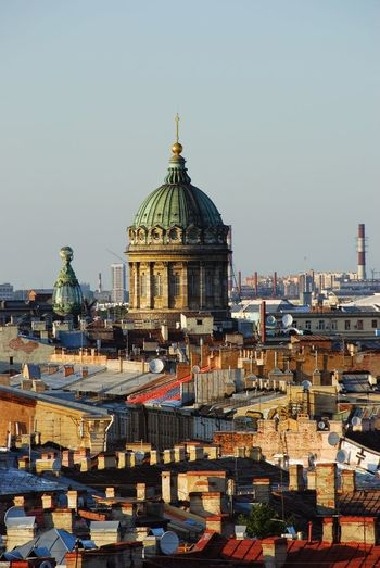 Saint isaac cathedral and cityscape against sky