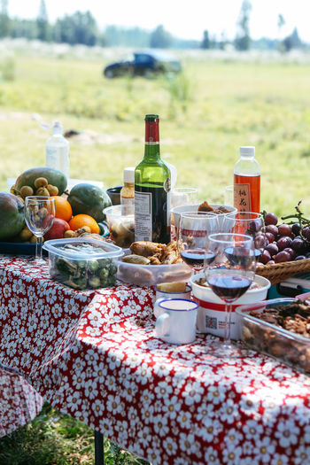 Food with drinks on table in yard