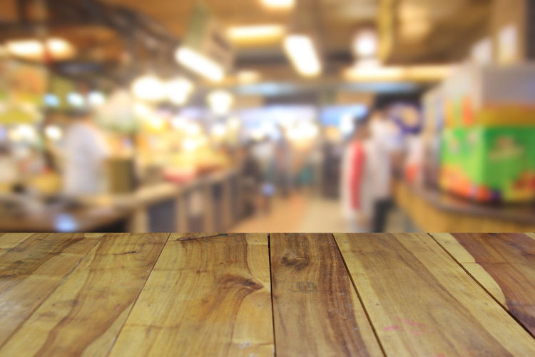 blurred image wood table and abstract people in food center with light bokeh Blurred; Blur; Busy; Interior; Defocused; Decoration; Chair; Mall; Cafe; Table; Leisure; Kitchen; White; Retail; Canteen; Coffee; Business; Restaurant; Light; Sit; People; Dinner; Court; Lifestyle; Focus; Desk; Center; Blurry; Crowd; Dining; Vintage; Back Close-up Day Focus On Foreground Indoors  No People Table Wood - Material