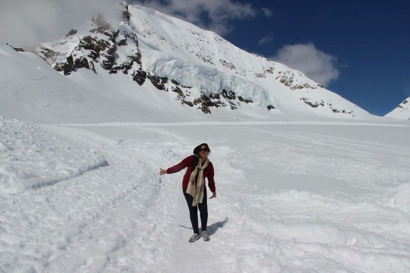 Woman skiing on snow covered mountain