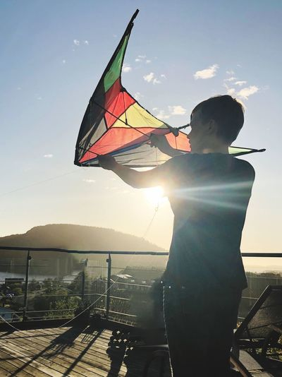 Kite Sky One Person Real People Leisure Activity Nature Sunlight Lifestyles Sea Wind