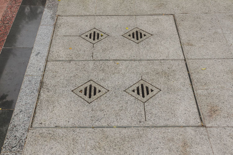 Drain Drain Hose Backgrounds Day Design Drainage Flooring Footpath Full Frame Geometric Shape High Angle View No People Outdoors Pattern Rectangle Shape Textured  Tile Tiled Floor Triangle Shape