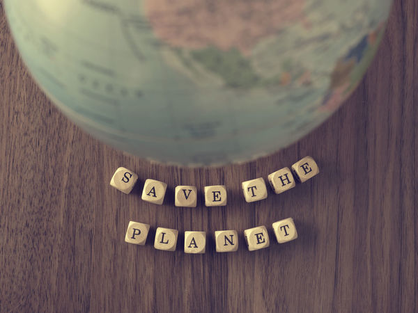 Save the planet Concepts Earth Nature Alphabet Climate Close-up Communication Day Ecology Environment Environmental Damage Indoors  Metaphor No People Planet Protect Save Table Text Top View Wood - Material