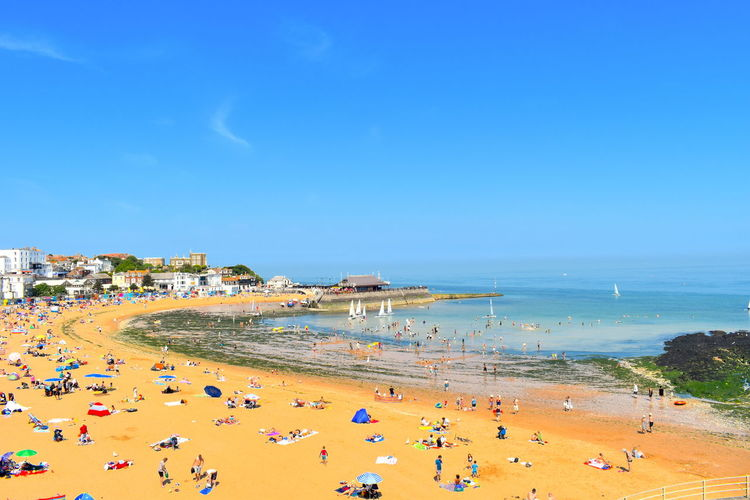 High angle view of people on beach against blue sky