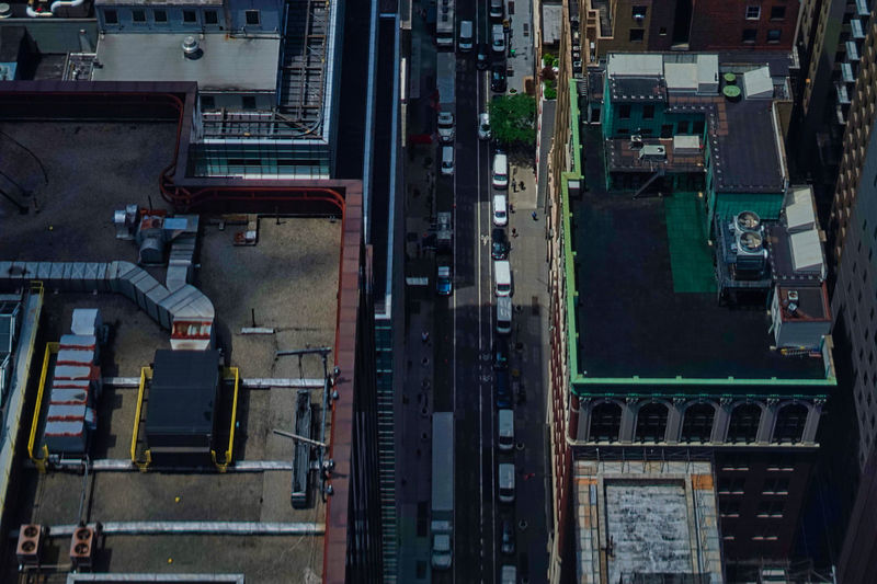 High angle view of railroad tracks by road in city