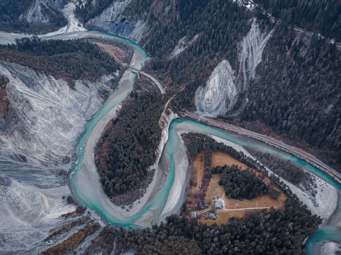 Aerial view of river flowing amidst valley