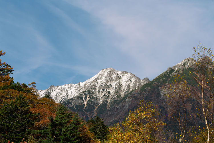 Scenic view of mountain against sky during autumn