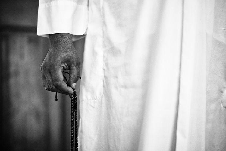 Close-up of monk holding prayer bead