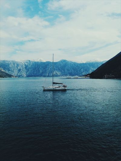 Sailboat moored at harbor