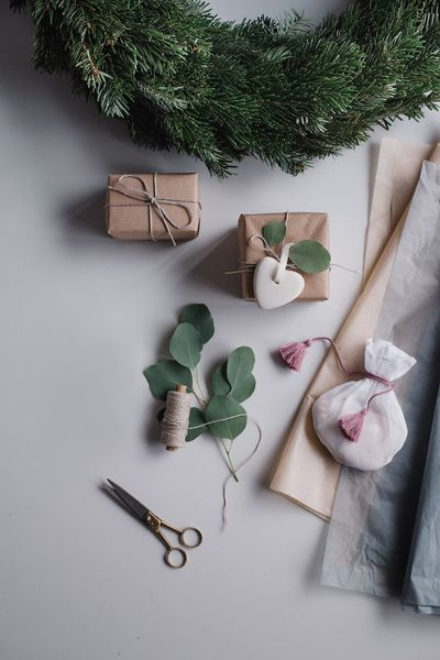 christmas gifts are being wrapped Advent Wreath Scissors Wrapping Presents Gifts Christmas High Angle View Table Plant No People Indoors