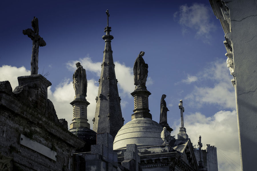 La Recoleta Cemetery, Buenos Aires, Argentina Upper class death in Argentina. The myriad of tombs and mausaleums open to the public housing the wealthy and famous of Argentine society. A macabre place of death and celebration. The Photojournalist - 2018 EyeEm Awards Ancient Civilization Architectural Column Architecture Art And Craft Belief Building Building Exterior Built Structure Cloud - Sky History Low Angle View Nature No People Ornate Outdoors Place Of Worship Religion Sky Spire  Spirituality The Past Tourism Travel Travel Destinations