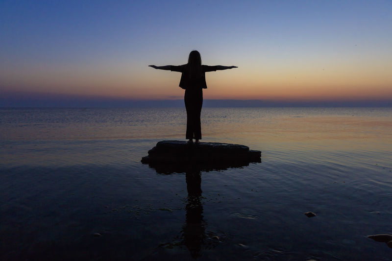 Baltic Sea Arms Outstretched Arms Raised Beauty In Nature Holiday Horizon Over Water Human Arm Leisure Activity Lifestyles Limb One Person Outdoors Real People Scenics - Nature Sea Silhouette Sky Standing Sunset Sweet Food Tranquility Trip Water Öland