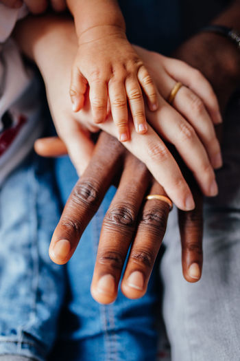 Human Hand Hand Human Body Part Body Part Real People Finger Human Finger People Indoors  Close-up Women Selective Focus Adult Togetherness Group Of People Focus On Foreground High Angle View Lifestyles Bonding Care Family
