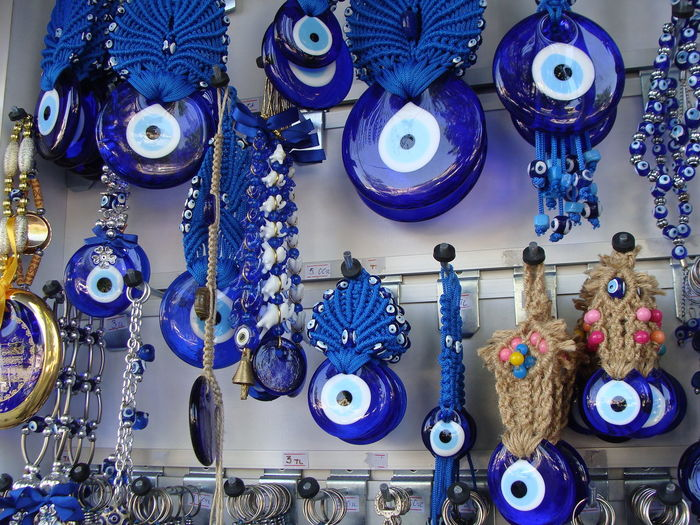 Charms for evil eye protection hang in a shop in Istanbul Turkey Blackandwhite Charms Evil Eye Evil Eye Charms Turkey