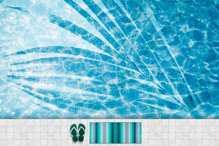 Pool float, ring floating in a refreshing blue swimming pool Blue Clean Day Directly Above Floating On Water Nature No People Pattern Pool Poolside Reflection Rippled Summer Sunlight Swimming Swimming Pool Tile Transparent Trip Turquoise Colored Vacations Water