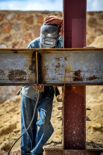 Welder working at construction site