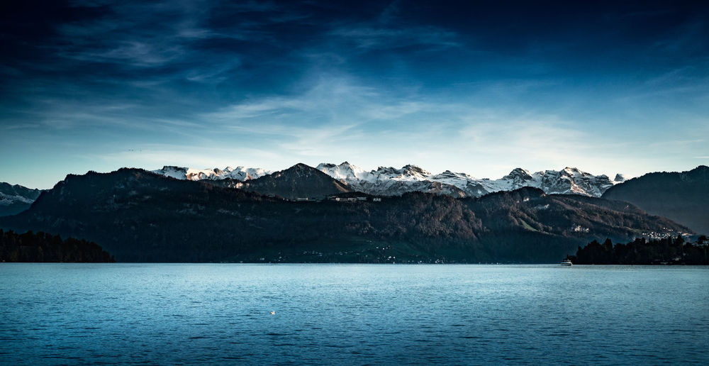 Mountain Sky Water Scenics - Nature Beauty In Nature Tranquil Scene Tranquility Mountain Range Nature Waterfront Cloud - Sky Lake Environment No People Idyllic Non-urban Scene Outdoors View Into Land Snowcapped Mountain