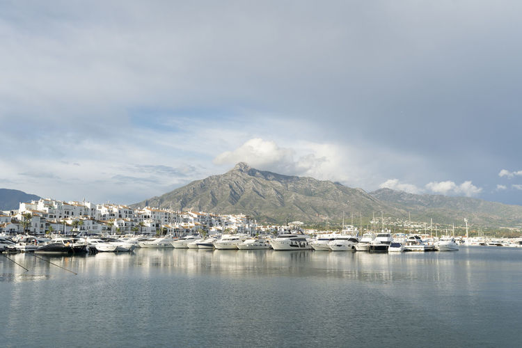 Puerto Banus SPAIN Mountain Clouds And Mountains Harbour Harbour View Sky Cloud - Sky Scenics - Nature Beauty In Nature Day Waterfront Nautical Vessel Sea Nature Transportation No People Moored Tranquil Scene Mountain Range Outdoors Tranquility Yacht Sailboat Marina