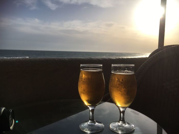 Evening beer on the beach at sunset Beer On The Beach Sunset Sea Horizon Over Water Drink Alcohol Sky Beach Cloud - Sky Scenics Outdoors Beauty In Nature Sand