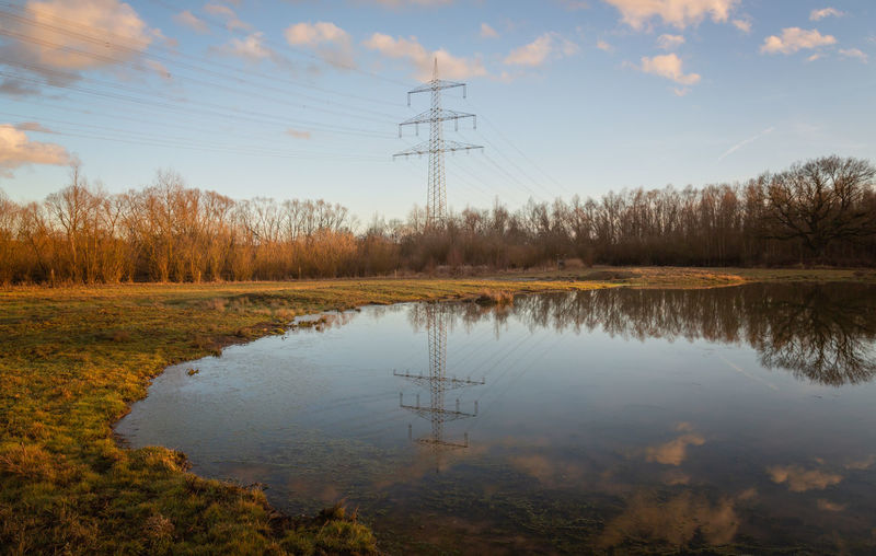 Sky Reflection Water Electricity Pylon Cloud - Sky Tranquility Technology Electricity  Nature Beauty In Nature Tranquil Scene Lake Tree Scenics - Nature Power Line  No People Fuel And Power Generation Power Supply Outdoors Electricity  Power Line