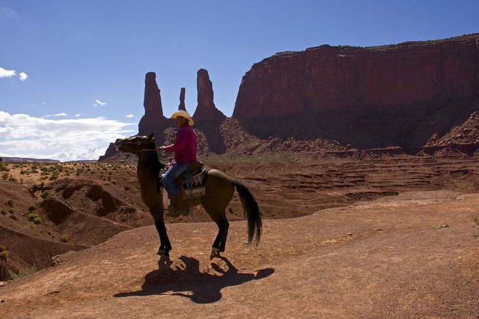 Monument Valley United States Beauty In Nature Man On Horseback Nature Real People Rock Formation Sunlight
