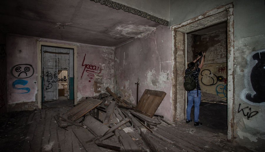The Secret Spaces Architecture One Person Only Men Walking Men People Abandoned Abandoned Buildings Abandoned House Graffiti Photography Wide-angle House Empty Room Empty House Destroyed Building Destroyed House EyeEmNewHere Motion Indoor Photooftheday