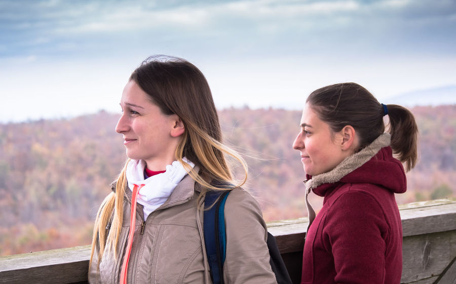 Two young women watching the landscape from the top of the tower Bonding Casual Clothing Day Focus On Foreground Friendship Headshot High-stand Landscape Backgrounds Leisure Activity Lifestyles Mountain Nature Outdoors People Real People Sky Sky Background Smiling Togetherness Two People Warm Clothing Women Young Adult Young Women Young Women Style The Portraitist - 2017 EyeEm Awards