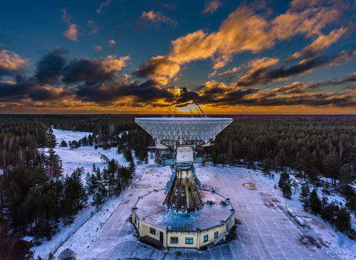 Ventspils International Radio Astronomy Centre at sunrise captured from a DJI Phantom drone. This used to be a soviet spy communication system that's not converted to a radio telescope Drone  Latvia Science Spying Architecture Astronomy Beauty In Nature Built Structure Cloud - Sky Cold Temperature Environment Environmental Conservation Nature No People Outdoors Radio Telescope Renewable Energy Satellite Dish Scenics - Nature Sky Snow Spy Sunset Ussr Winter