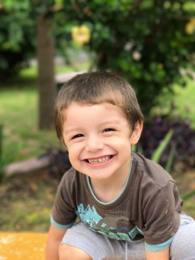Portrait of smiling boy playing outdoors