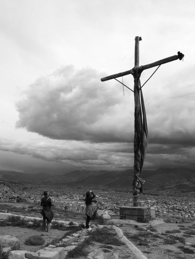 Cross with fabrics on a hill, near to Cusco, Peru. Adventure Black & White Black And White Blackandwhite Photography Cloud Cloudy Cross Fujifilm Finepix S1500 Outdoor Outdoors Scenic Silhouette Sky Travel Travel Photography Traveling Story My Favorite Photo